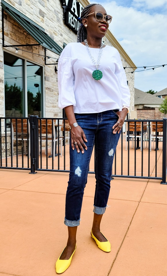 Fall style white top and blue jeans